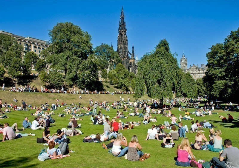 People relaxing on a sunny day in Princes Street Gardens, Edinburgh, Scotland | What to Do in Edinburgh in 3 Days