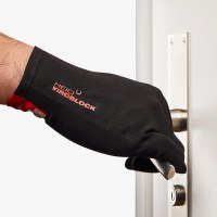Photograph of a hand wearing the HeiQ Viroblock Antimicrobial black gloves, and opening a door handle. The words HeiQ Viroblock are written small in red on the back of the glove. There is a red tag on the wrist of the glove that says, Swiss Tech Inside