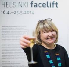Photographer at the opening of her exhibition 15.4.2014. Photo Laura Kotila.