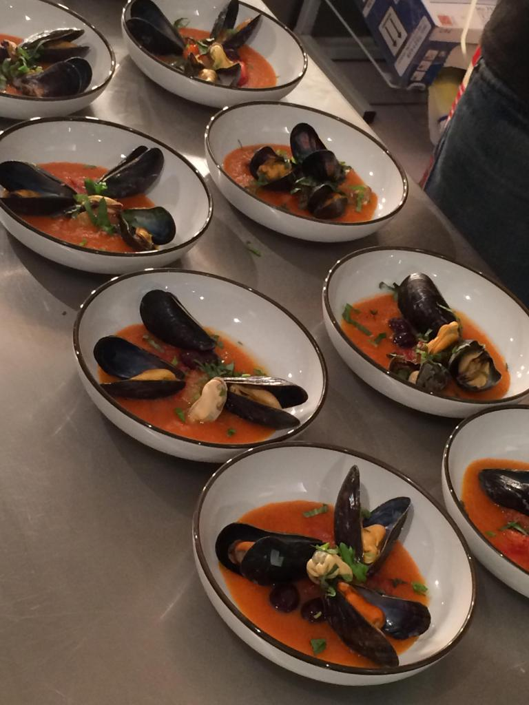 Mussels with tomato coulis, olives and orange