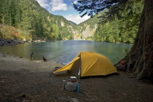 Fisherman Tent Camping At A Wilderness Lake