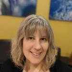 Ms. Rosemarie in her online studio.