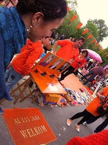 On KingsDay people show newly invented games in the street.