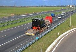 """""""War Department 33"""" WD 33 Locomotive on its way to Belgium."""