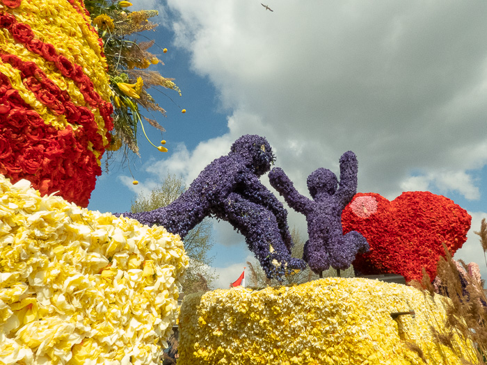 Endless row of floats on flower parade through the Dutch bulb fields love jumping figures Keith Herring