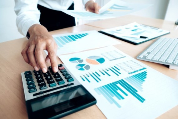 finances saving economy concept female accountant or banker use calculator 1421 90 - Simple Steps to Success: Setting up your Business made Simple