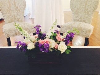 A stunning arrangement of flowers assembled in a wine-box to compliment the lounge area.