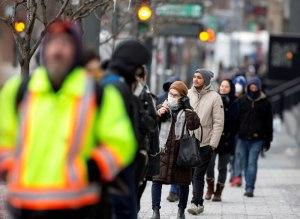 Crowd walking on Sidewalk. Credit: Christinne Muschi/Reuters