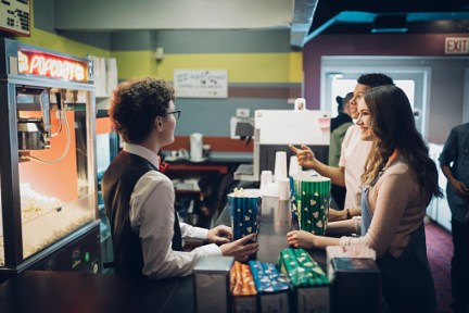 Youth working movie theatre concessions