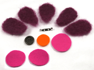 Materials to make a needle felted flower brooch