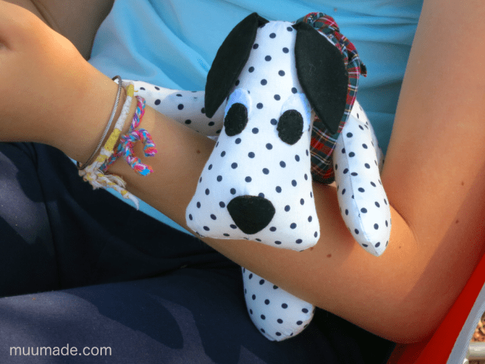 Huggable Doggy, a Dalmatian, in a child's arm