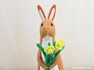 A Little Felt Rabbit with a bouquet of tiny daffodils made from pipe cleaners