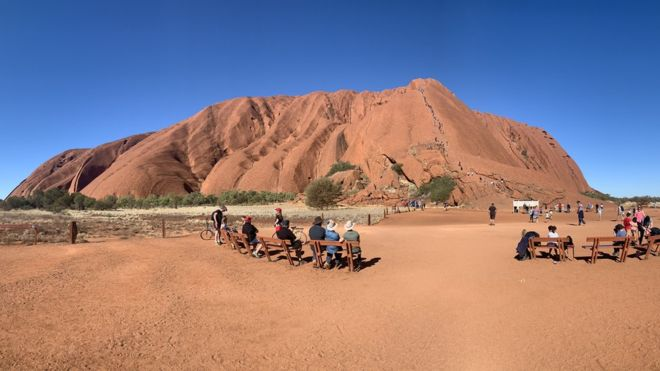 Uluru tourists draw controversy ahead of climb ban - image  on https://muvison.com
