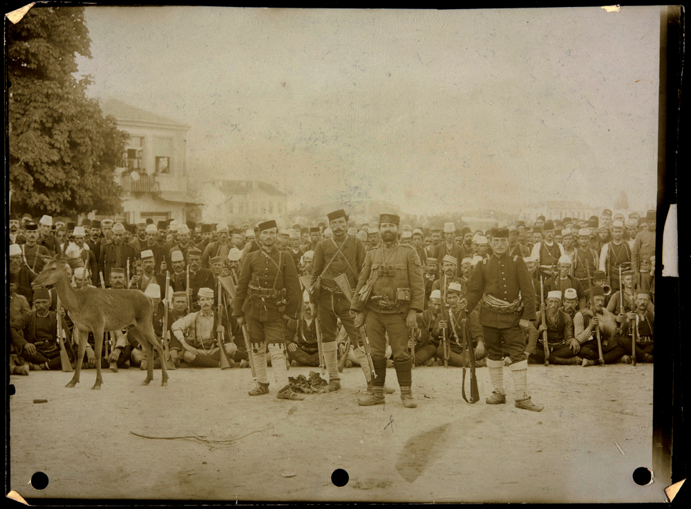 """Photograph inscribed on verso in Mary Matthews' hand: """"Neazin Bey [sp] with his band at Monastir, Turkey in Europe, July 1908. He was one of the heroes of the Constitution proclamation on July 23, 1908 at Monastir."""""""