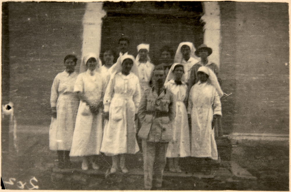 Dr. Haigh and nurses at the Anglo-Serb Hospital in front of the entrance of today's building of NI Institute and Museum Bitola, 1917-18