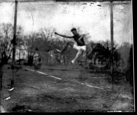 photo of Athlete Performing a High Jump