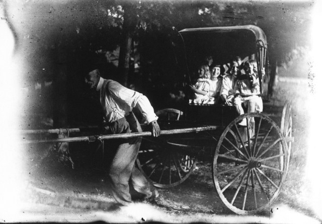 photo of Older Man Pulling a Buggy
