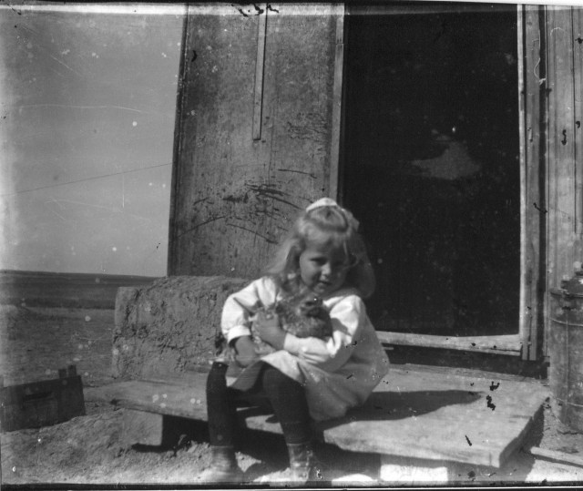 photo of Unidentified Girl Holds Chicken
