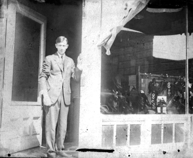 photo of Unidentified Man In Front of a Shop