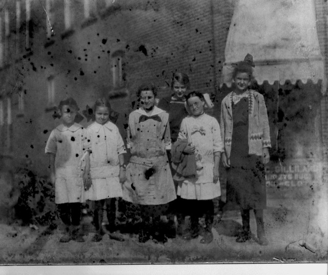 photo of Unidentified Women Standing in Front of Building