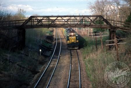 Photo of train under Old Lincoln Highway Bridge