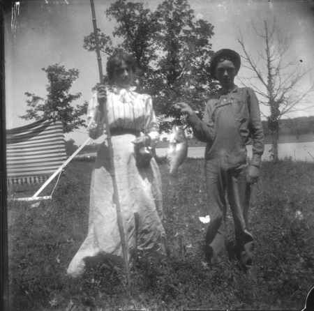 photo of Two Unidentified Children with a Fish and Pole