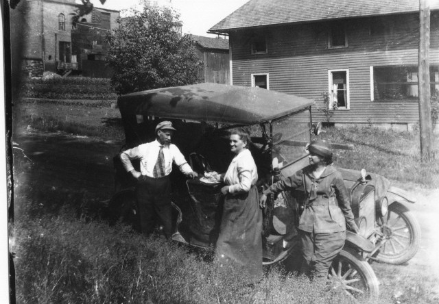 photo of Unidentified People in Front of a Car