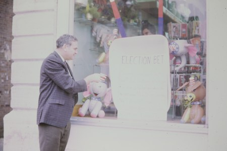 Photo of Dewey Humphries posting the election bet poster
