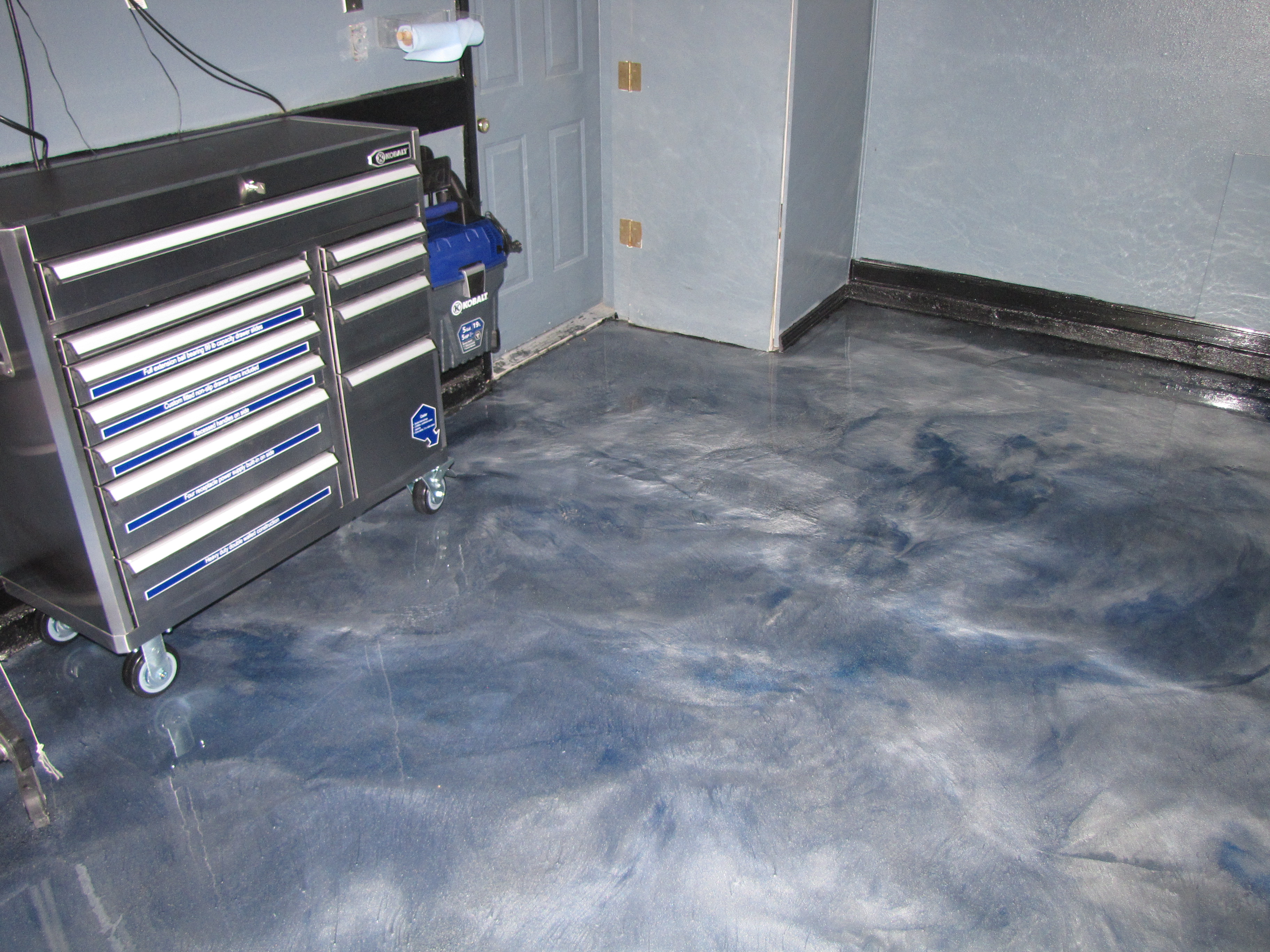 Garage Floor Coated With Metallic Epoxy  MVL Concretes Blog