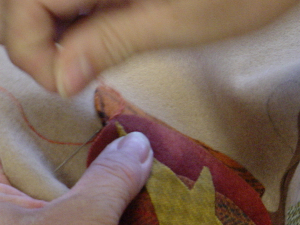 Then take a button hole stitch