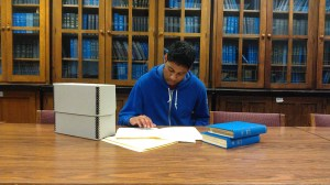Ajay Yalamanchi working on the Charles S. Thaeler, Jr. papers