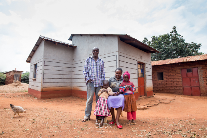 Nzioka Kivanga, 29, with his family and niece at their home in Machakos County, Kenya, on 20th July 2016. Since he started planting drought-resistant seed from Dryland Seed Company, Nzioka has seen his harvests increase. He is now able to support his wife and 3-year-old daughter, and has even built a brick house from the proceeds from sale of continuous bumper harvests.