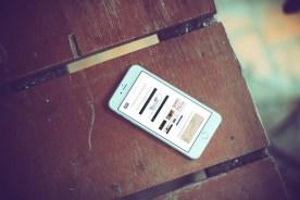 MW marketing Website iPhone on Desk