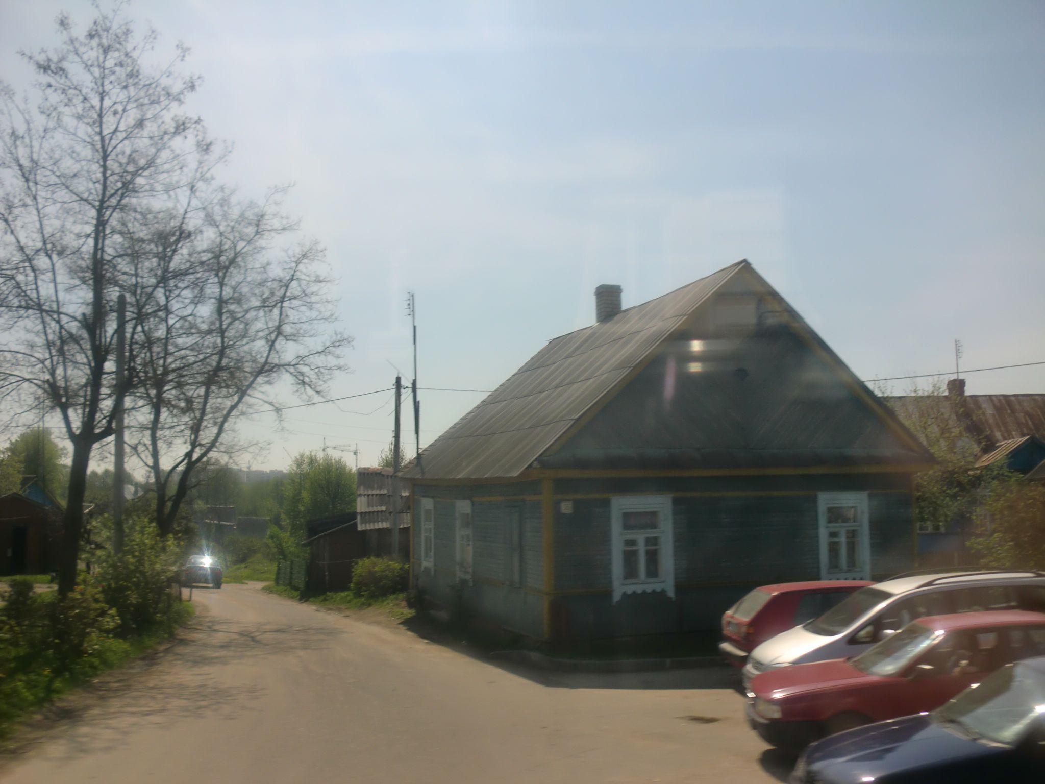 From Vilnius to Minsk by bus- Cars parked in front of a house