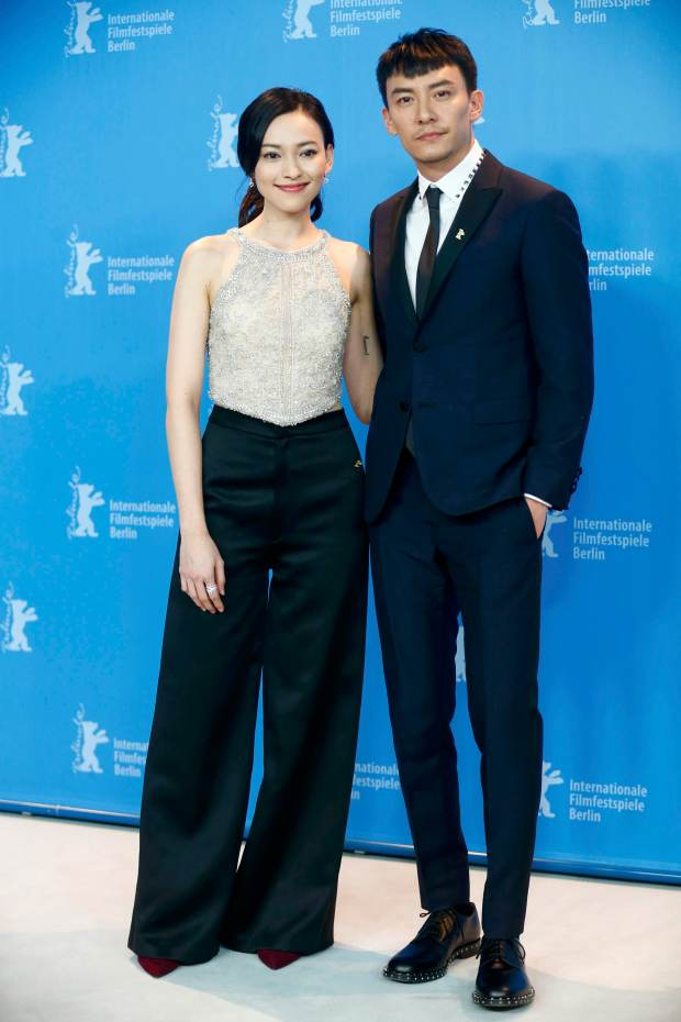 Actress Yiti Yao and actor Chen Chang pose during a photocall to promote the movie 'Mr. Long' at the 67th Berlinale International Film Festival in Berlin