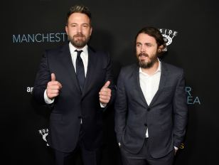 "Casey Affleck, right, a cast member in ""Manchester by the Sea,"" poses with his brother Ben Affleck at the premiere of the film at the Samuel Goldwyn Theater on Monday, Nov. 14, 2016, in Beverly Hills, Calif. (Photo by Chris Pizzello/Invision/AP)"