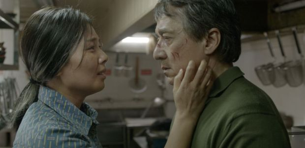 Liu Tao and Jackie Chan looking to each other