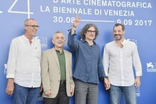 "Director Ziad Doueiri (2ndR) poses with actor Adel Karam (R), actor Kamel El Basha (L) and actor Camille Salameh (2ndL) during the photocall of the movie ""The Insult"" presented in competition ""Venezia 74"" at the 74th Venice Film Festival on August 31, 2017 at Venice Lido. / AFP PHOTO / Tiziana FABI"