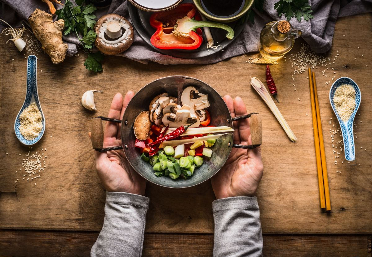 Vegetarian Stir Fry Cooking Preparation Women Female Hands Holding Little Wok Pot With Chopped Vegetables For Stir Fry On Kitchen Table Background Wi