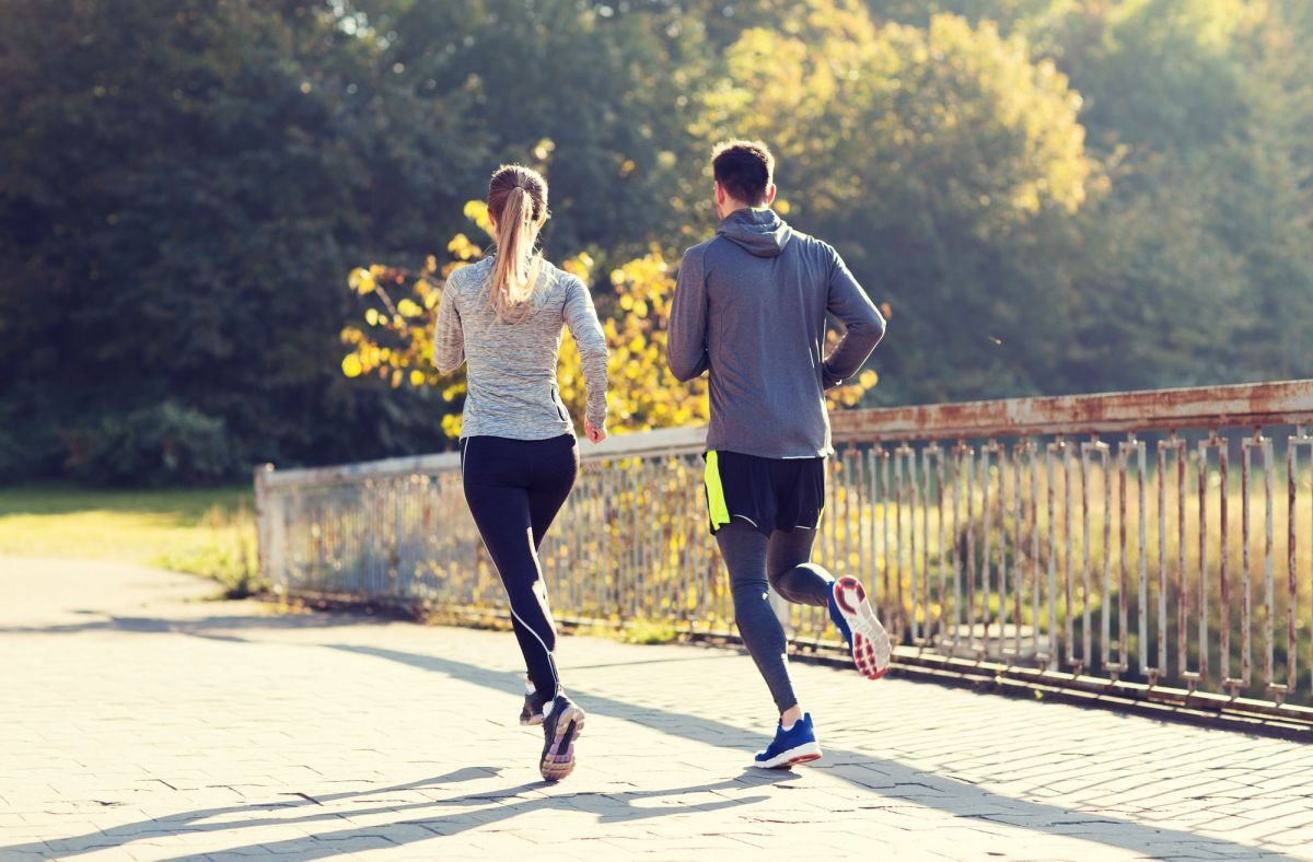 Fitness Sport People And Jogging Concept Couple Running Or Jogging Outdoors Couple Running Or Jogging Outdoors
