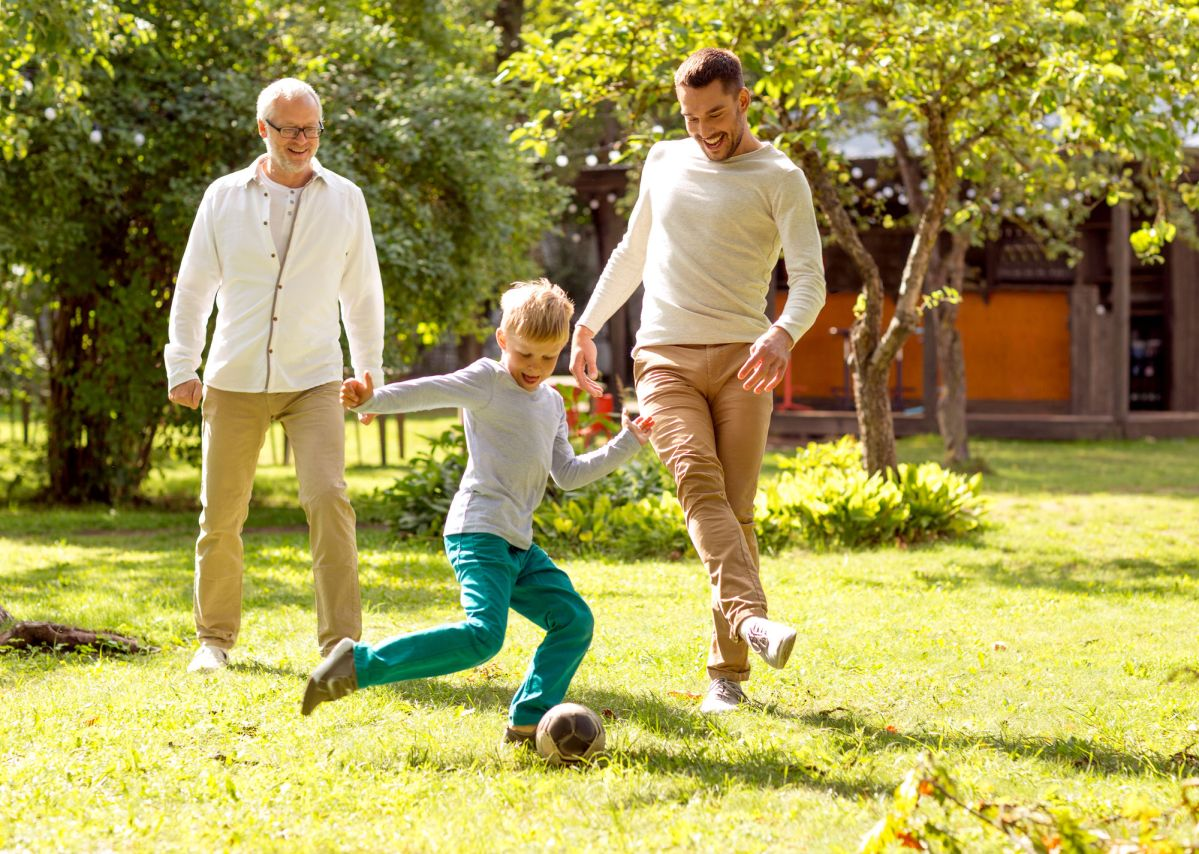 Family Happiness Generation Home And People Concept Happy Family Playing Football In Front Of House Outdoors