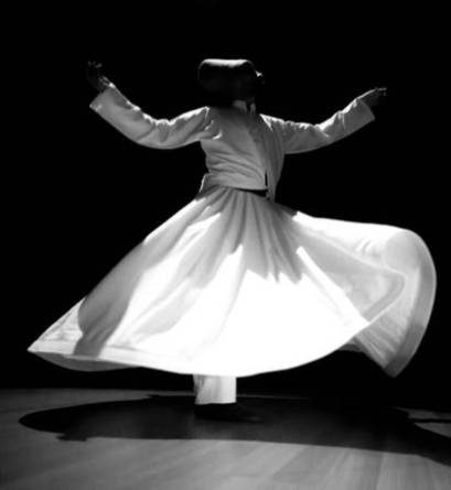 90247594-the-image-of-a-whirling-dervish-in-the-darkness