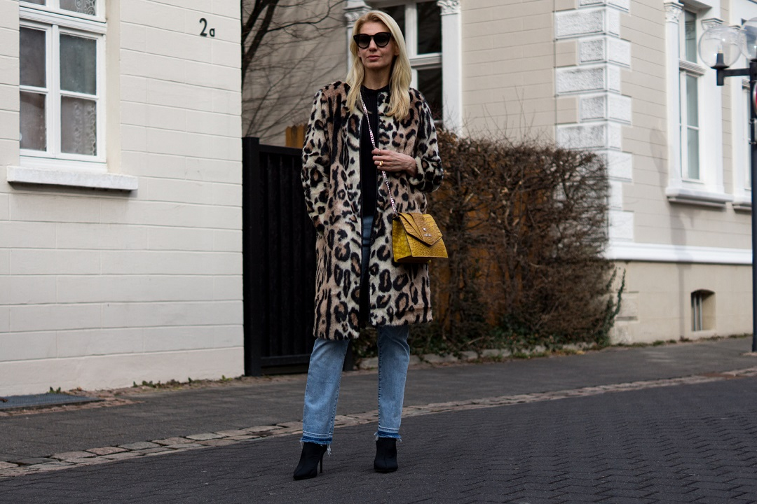 Pattern and fabric mix with a leo coat and statement bag