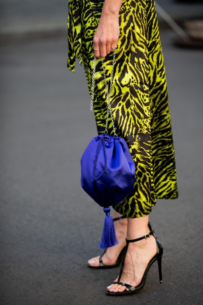 Ganni skirt and Mango bag during Berlin Fashion Week