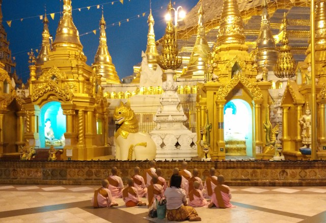 Female novices praying at Shwedagon Pagoda, Yangon, Myanmar