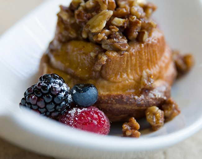 PHOTO: Cinnamon sticky bun topped with pecans and fresh berries.