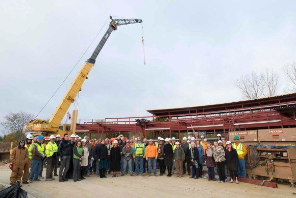 PHOTO: Despite the blustery day, the construction team was excited to celebrate the success of the project so far.