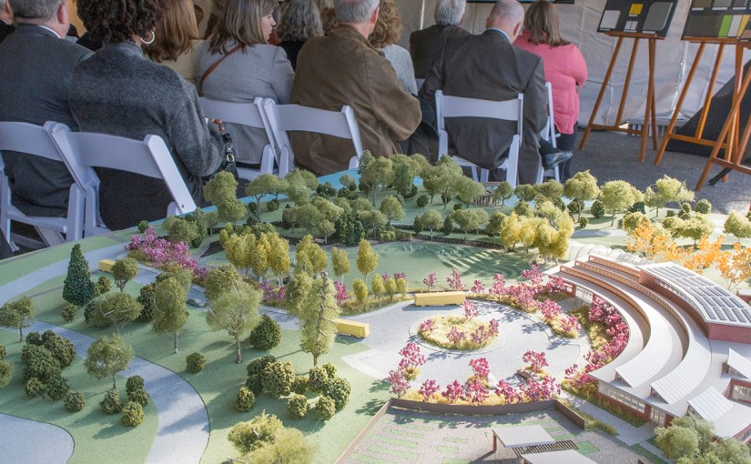 PHOTO: The groundbreaking ceremony; with model of the campus in the foreground.