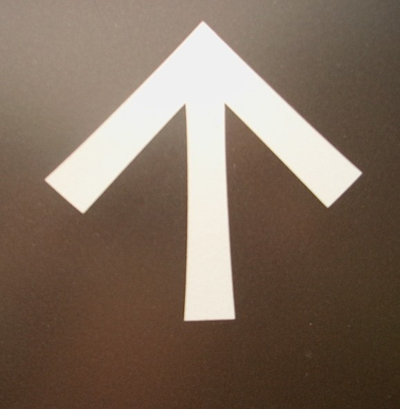 PHOTO: Standard white arrow used to show directions on signs at the Garden