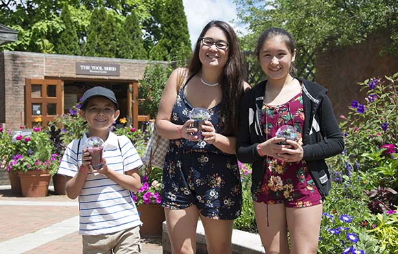 Military family holding small terrariums made at the Garden.
